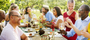 people laughing at outdoor afternoon dinner party